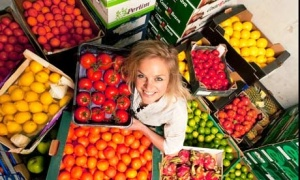 Jenny Dawson with trays of fruit and vegetables